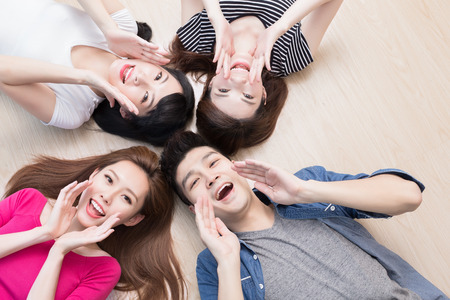Photo for young people smile happily and lying on floor - Royalty Free Image