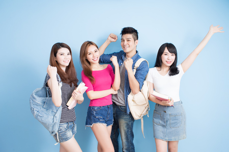 Photo for happy group student feel free on the blue background - Royalty Free Image