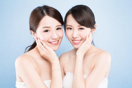 Foto de two beauty woman with healthy skin care on the blue background - Imagen libre de derechos