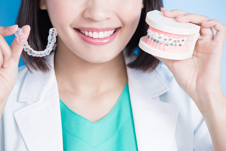 Photo for woman dentist take brace on the blue background - Royalty Free Image