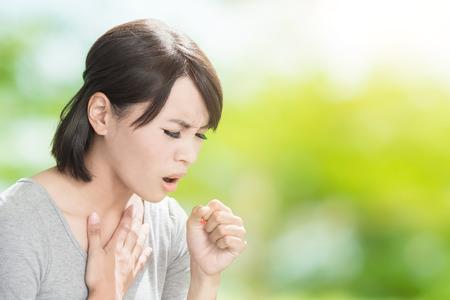 Foto de woman get sick and cough on the green background - Imagen libre de derechos