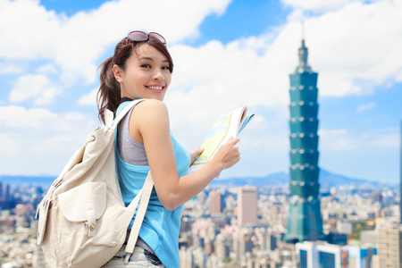 Photo for Happy travel woman take map and look to you in taipei - Royalty Free Image