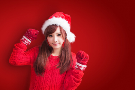 Foto de beauty woman with christmas on the red background - Imagen libre de derechos