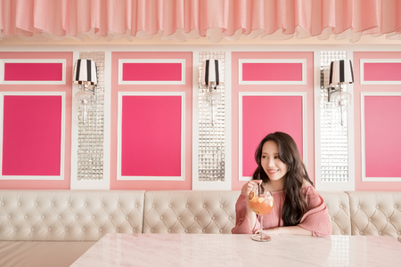 beauty woman drinking juice and sit in restaurant