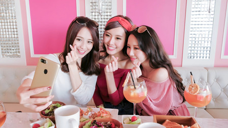 Photo for beauty women selfie and dine in restaurant - Royalty Free Image