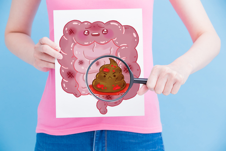 Foto de woman take unhealth intestine billboard and magnifying on the blue background - Imagen libre de derechos