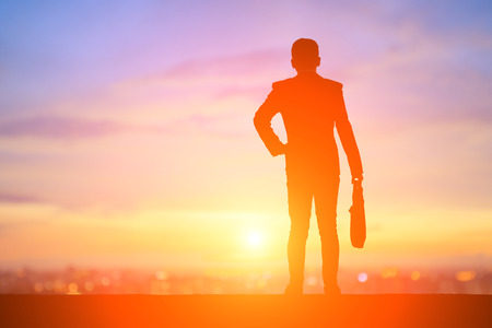 Photo for silhouette of business man look somewhere with sunset - Royalty Free Image