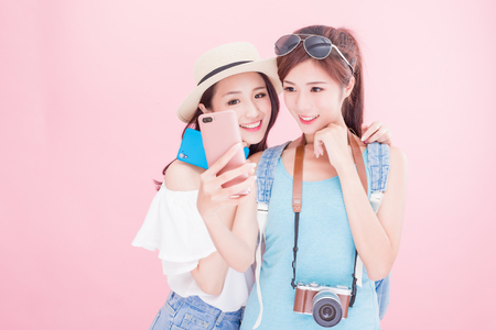 Foto per two beauty woman selfie happily and go on the travel - Immagine Royalty Free