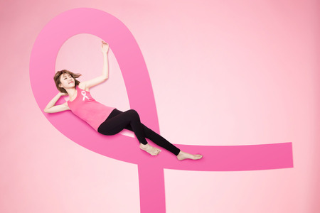 Photo for woman lying on floor and feel relax with prevention breast cancer concept - Royalty Free Image