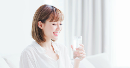 Photo for Beauty woman drink water and feel happily at home - Royalty Free Image