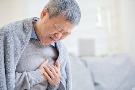 Photo pour asian elderly sick man feeling sharp strong pain because of heart attack - image libre de droit