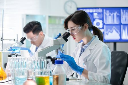 Photo for asian scientist team use microscope in the laboratory - Royalty Free Image