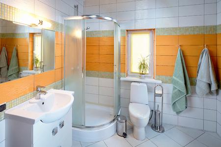 Foto de Interior of Washroom in Orange Tones in Dom in Koptevka Hotel - Imagen libre de derechos