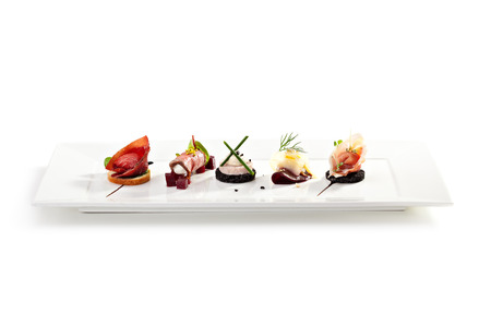 Foto de Meat Canapes on White Dish - Imagen libre de derechos