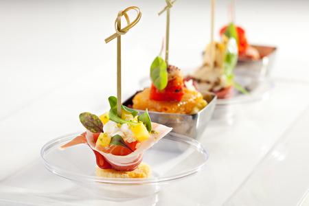 Foto de Delicious Buffet Food on White Dish - Imagen libre de derechos