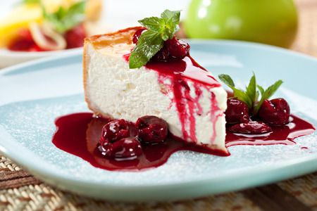 Photo for Dessert - Cheesecake with Berries Sauce and Green Mint - Royalty Free Image