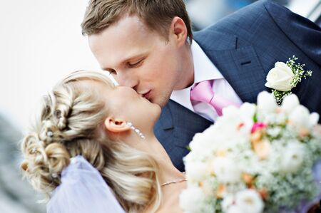 Kiss the bride and groom at a wedding