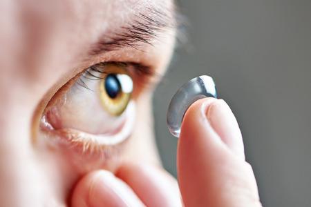 Foto de Medicine and vision - young woman with contact lens - Imagen libre de derechos