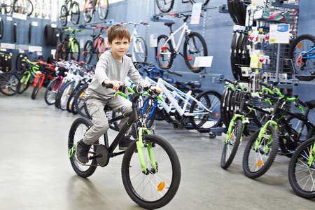 Boy riding a bicycle in a sports supermarket
