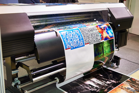 Photo for Big rolling wide plotter printer in work - Royalty Free Image
