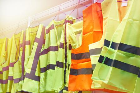 Foto de Colored, reflective vests for drivers and road workers - Imagen libre de derechos