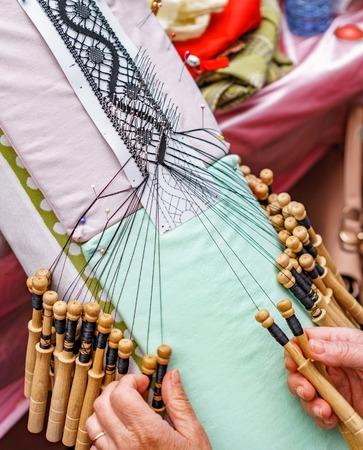 Photo pour Top view of an elderly woman working on bobbin lace - image libre de droit