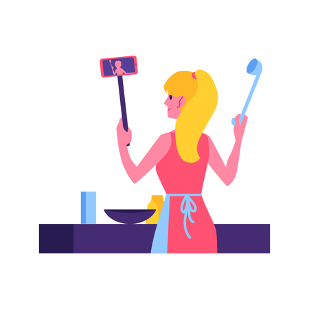 Ilustración de Vector cute woman in apron cooking in kitchen making video tutorial on selfie stick with smartphone. Video blogger produce cook and food content. Dish vlogs youtuber girl concept. - Imagen libre de derechos