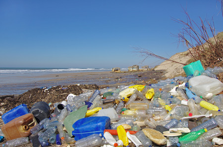 Foto de garbages, plastic, and wastes on the beach after winter storms - Imagen libre de derechos