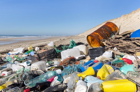 Foto de garbages, plastic, and wastes on the beach after winter storms. - Imagen libre de derechos