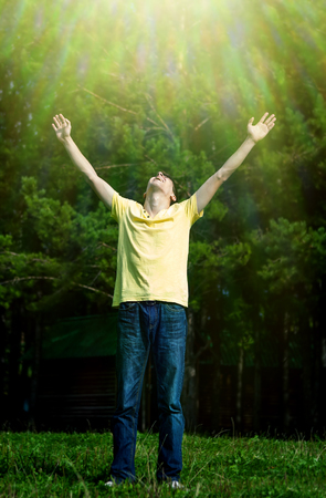 Photo for Toned Photo of Happy Young Man with Hands Up on the Nature Background - Royalty Free Image