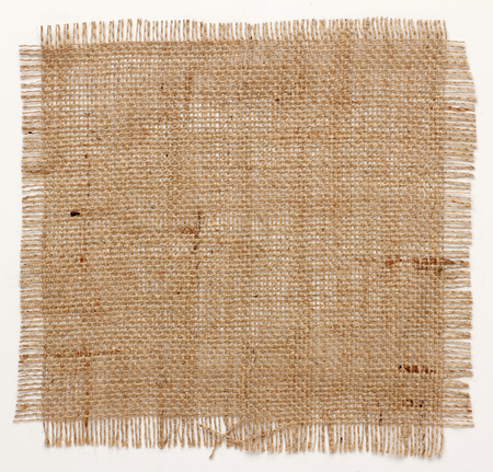 Photo for texture of Burlap hessian square with frayed edges on white background - Royalty Free Image