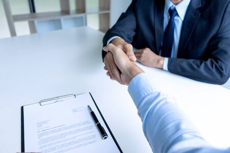 Photo for Successful business job interview, Young attractive asian employee handshaking with boss - Royalty Free Image