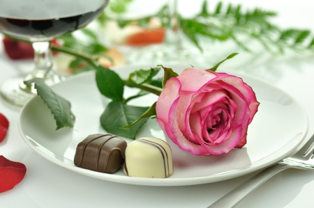 Photo for holiday romantic dinner with rose on a plate  - Royalty Free Image