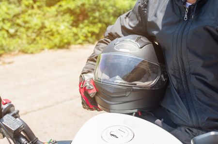 Foto de Man in a Motorcycle with helmet and gloves is an important protective clothing for motorcycling throttle control,safety concept  - Imagen libre de derechos