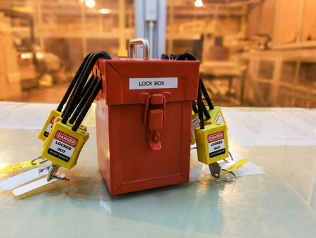 Foto de Red key lock and tag for process cut off electrical,the toggle tags number for electrical log out tag out - Imagen libre de derechos