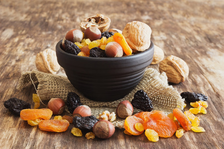 Photo for various dried fruits and nuts on an old wooden background. close-up. judaic holiday tu bishvat. health and diet food. selective focus - Royalty Free Image