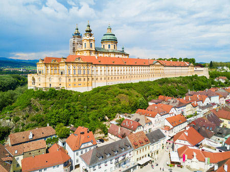 Photo pour Melk Abbey Monastery aerial panoramic view. Stift Melk is a Benedictine abbey in Melk, Austria. Monastery located on a rocky outcrop overlooking the Danube river and Wachau valley. - image libre de droit