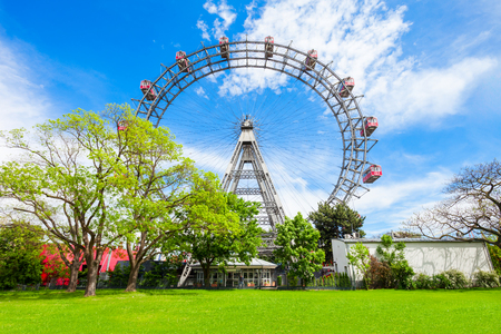 Photo for The Wiener Riesenrad or Vienna Giant Wheel 65m tall Ferris wheel in Prater park in Austria, Vienna. Wiener Riesenrad Prater is  Vienna's most popular attractions. - Royalty Free Image