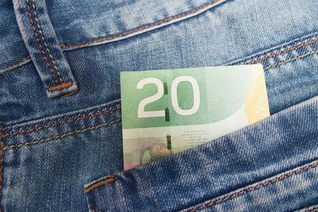 Foto de Canadian Dollar in a jeans pocket - Imagen libre de derechos