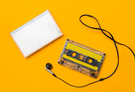 Photo for audio cassete and headphones, on yellow background - Royalty Free Image