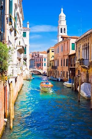 Foto de A boat in a canal in Venice, Italy - Imagen libre de derechos