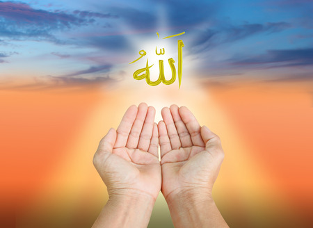 Foto de Hands of man praying to allah god of Islam on a sunset.The words spell is Allah means the God of Islam. - Imagen libre de derechos
