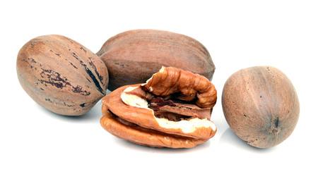 Photo pour Pecan nuts isolated on a white background. - image libre de droit