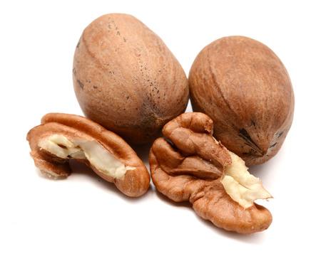 Photo pour Pecan nuts isolated on white background, selective focus - image libre de droit