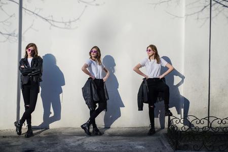 Foto de Dissociative disorder, girl in black against the background of the white wall - Imagen libre de derechos