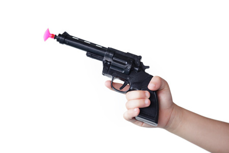 Photo pour hand of children holding toy gun isolated on white background. - image libre de droit