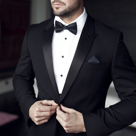 Photo for Sexy man in tuxedo and bow tie posing - Royalty Free Image