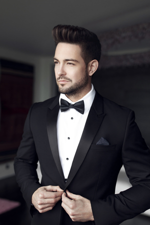 Photo for Sexy fashionable man celebrity in tuxedo indoor - Royalty Free Image