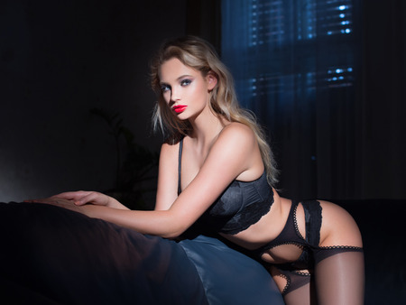 Photo for Sexy young blonde woman in underwear posing at night - Royalty Free Image