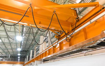 Foto de factory overhead crane on a yellow beam Close up - Imagen libre de derechos